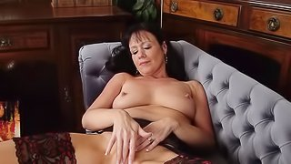 Busty brunette Elise Summers is playing with herself