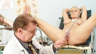 Voluptuous blonde goes to the doc