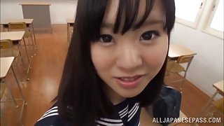 Naughty Japanese teen in school uniform sucks cock