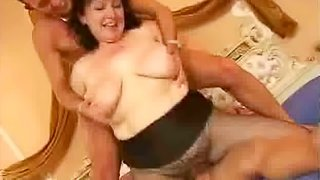 Mature Italian slut sucks two cocks and takes them in her hairy snatch