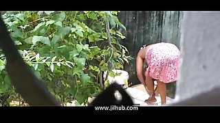 Sri Lankan Lady Showering out side
