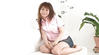 Chatty Japanese girl in a blouse and miniskirt