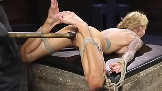 Busty blonde Sarah Jessie with tattoos learns more about BDSM
