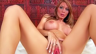Long legged mom Amber with huge fake tits spreads her legs and shows her pink love hole. Then sexy naked milf in pink shoes fills her love tunnel with blue dildo for the camera. Enjoy!