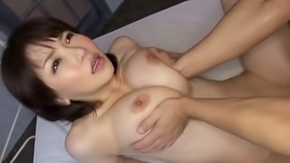 Naturally beautiful Japanese babe spreads her legs for a thick cock