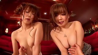 A couple of stunning Asian cuties share a cock