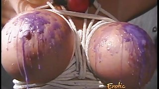 Giant melons gets tied up and covered in candle wax