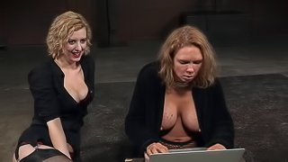 Chick in fishnet lingerie is tied up and spanked by her evil mistress