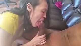 Loves suckling that 12 inch big cock