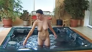 Sassy slut with droppy tits handles two dongs in this hot DP scene