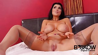 Naked Romi Rain models her tits and cunt as she chats