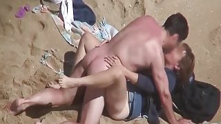 Kissing and fucking his sexy wife on the beach