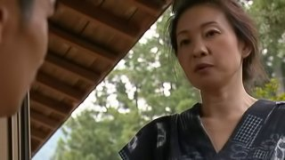 Mature Asian woman with big boobs enjoying a hardcore doggy style fuck