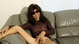 Hairy pussy vibrated by an Asian milf in sunglasses