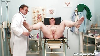 Short Haired Mature Lady Getting Ready For Pussy Examination