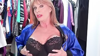 Attractive granny with big juggs in a blue bathrobe changing various lingerie before rubbing her old slit in her wardrobe