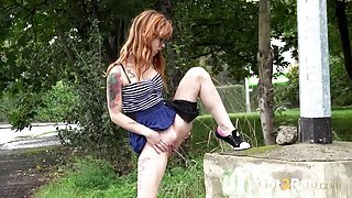 Punk in a miniskirt pees in public