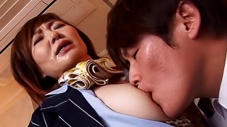 Mature Japanese pornstar gets a cumshot after getting drilled doggy style