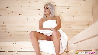Spy up the towel of the girl in the sauna