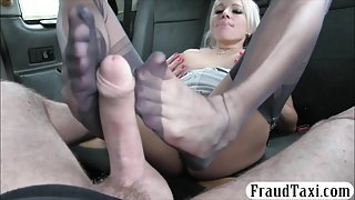 Busty passenger gets banged and footjob in the backseat