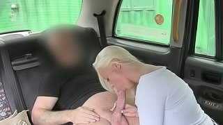 Blonde Sophie gives a blowjob in the car
