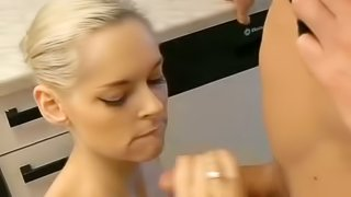 Amateur blonde gets fucked from behind and facialed in the kitchen