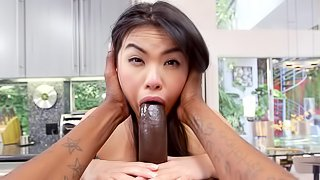 A sexy Asian with small tits is penetrated in her wet pussy