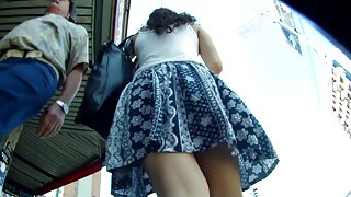 Ass in thong wind blown up skirt view in public