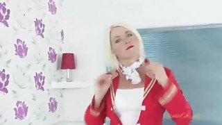 Mature blonde chick is sexy in a stewardess costume