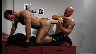 Hairy stud has a huge sex toy and his friend's fist punishing his ass