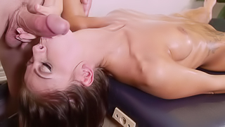 A brunette that has natural tits is getting cumshot on the table