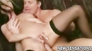 Busty hotwife in black stockings surrenders to her neighbor on her new couch
