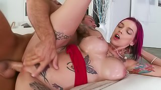 A fine redhead that has huge tits is fucked in her pierced pussy