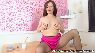 English milf Kitty Cream dildos her nyloned wet cunt