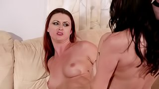 Two hot lesbians that love licking pussy use a strap on to have fun