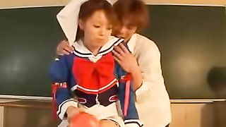 Cute Japanese teen in blue and white school girl costume opens her blouse and shows her small boobs while she makes out and lets her professor rub her crack under her white panty before he blows his spunk on her pretty face in a classroom.