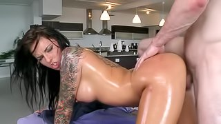 Stunning busty babe with nice tattoos gets more than a massage