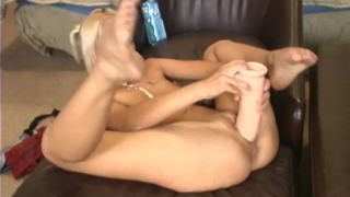 Blonde amateur stretching her pussy with a brutal dildo