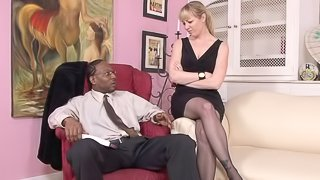 On her knees she begs for more black cock deep inside her
