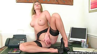 UK milfs Red and Holly Kiss wear stockings with suspenders