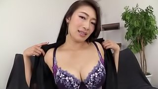 Japanese sexbomb slowly uncovers her huge tits in bra and masturbates