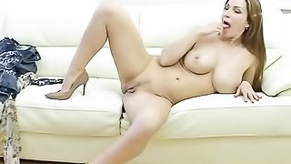 Beautiful Spanish chick gets naked and masturbates pussy on couch.