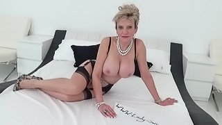 Mature Lady Sonia oils up her big tits