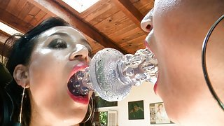 Hot babe sucks a glass dildo